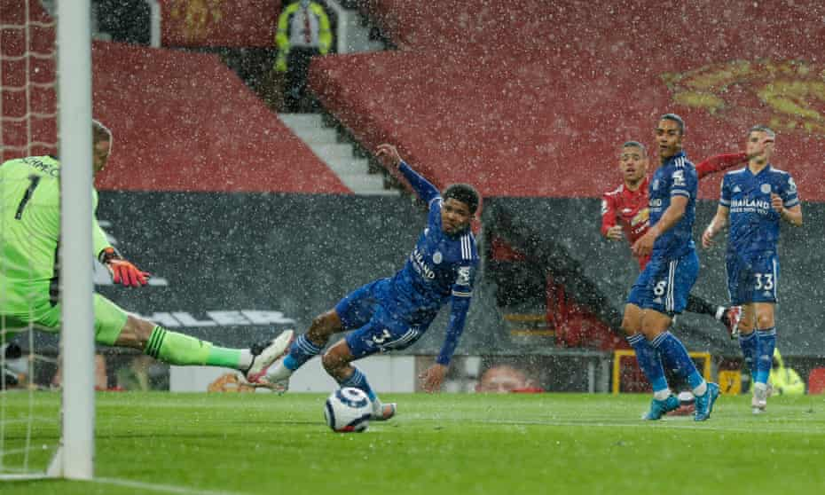 Mason Greenwood hits his shot through the heavy rain and past Leicester goalkeeper Kasper Schmeichel.