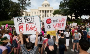 People gather at the Alabama State Capitol to protest against the state's new abortion law.