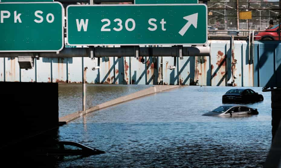Cars abandoned on a flooded highway Thursday in the Bronx borough of New York City.