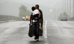 One of Yannis Behrakis's most celebrated photos – of a Syrian refugee carrying his daughter towards Greece's border with Macedonia, 2015.