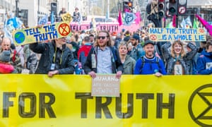 Protesters from Extinction Rebellion block roads in London