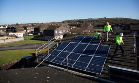 Solar panels are installed as part of a renewable green energy policy run by Reading local authority alongside solar panel companies.