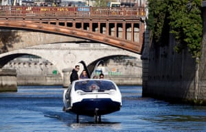 Paris, France: The SeaBubbles water taxi glides above the surface of the Seine River in front of Notre-Dame