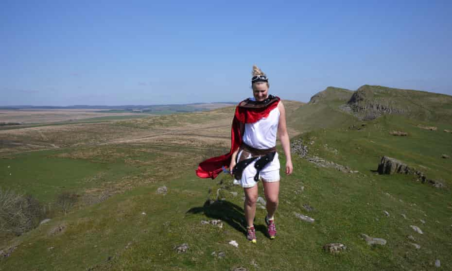 Anna McNuff walks Hadrian's Wall in costume.