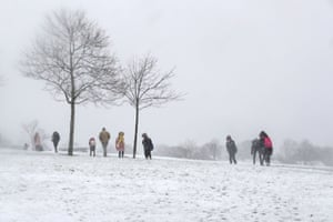 People make their way through the snow in Mauricewood Park in Penicuik, Midlothian, Scotland