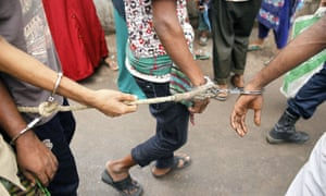 Police escort arrested men in Dhaka during an anti-militant crackdown across the country.