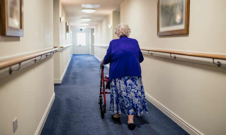 woman with walker in a care home