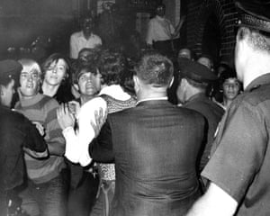 Crowd attempts to impede police arrests outside the Stonewall Inn on Christopher Street in Greenwich Village.