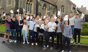 Students celebrate their A-level results at Brighton college in Sussex.