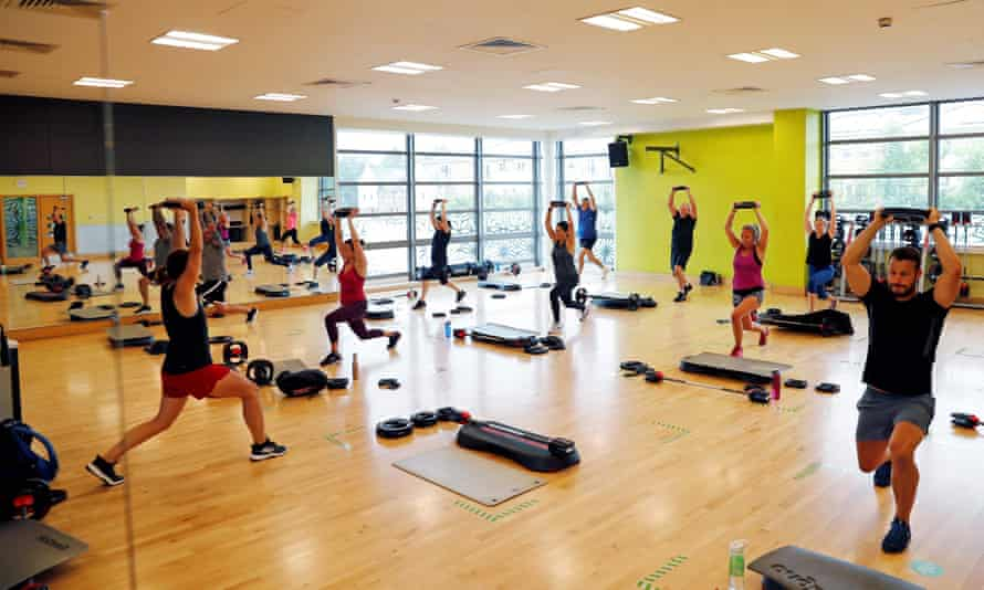 People take part in an exercise class at a Nuffield gym in Sunbury-on-Thames, west of London, pre-lockdown in July 2020.