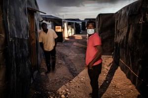 Migrant workers in El Nazareno shantytown