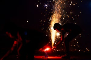 Children light firecrackers in Chennai
