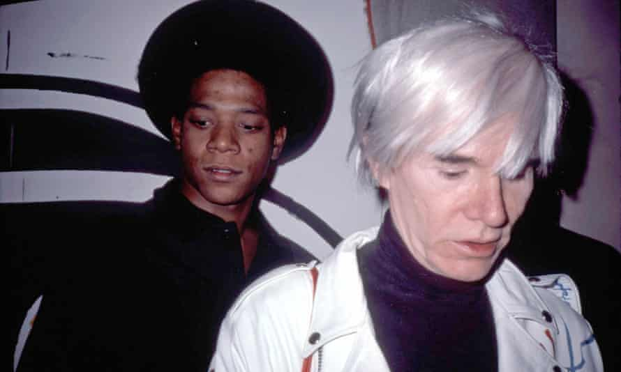 Basquiat with Andy Warhol at the opening of their show at the Tony Shafrazi Gallery, New York, in the mid 80s. Photograph: Everett Collection Inc/Alamy S