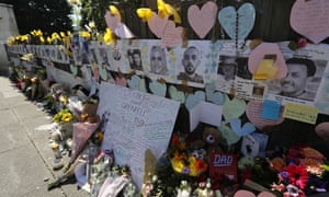 A wall near Grenfell Tower is covered with messages, flowers and tributes for the victims of the blaze.