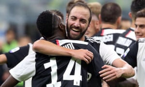 Gonzalo Higuain hugs his teammate Blaise Matuidi (No 14) after scoring the winner for Juve against Inter.