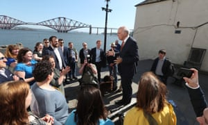 Sir Vince Cable, the Lib Dem leader, speaking to activists at a campaign event in South Queensferry, Edinburgh, with the Forth bridge in the background.