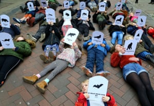 Pupils hold pictures of endangered and extinct animals during a youth strike against climate change in Canterbury, Kent, England.