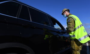 Australian Defense Force personnel work at a vehicle checkpoint