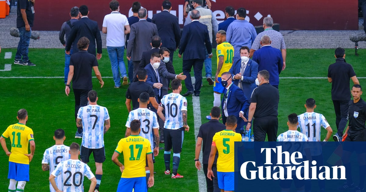 Chaos as Brazil v Argentina match abandoned after officials storm pitch in Covid-19 row – video