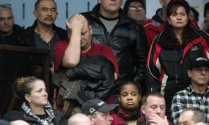 Reactions at a union meeting in Oshawa, Ontario, one of the regions also affected by the layoffs.