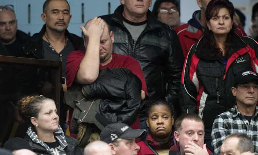 A union member reacts as union leaders speak at Local 222 in Oshawa, Ontario, on 26 November 2018. General Motors announced it was ceasing operations at five plants in the US and Canada, costing more than 14,000 jobs.