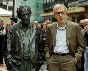 """2005Woody Allen imitates the pose of his statue at Oviedo city, Asturias region, northern Spain. Allen, who was awarded the """"Prince of Asturias"""" of Arts in 2002, is in Oviedo to participate in the events to mark the XXV anniversary of the """"Prince of Asturias"""" foundation."""