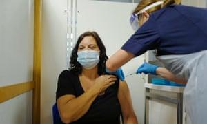 A nurse at the Royal Cornwall hospital giving a Covid jab
