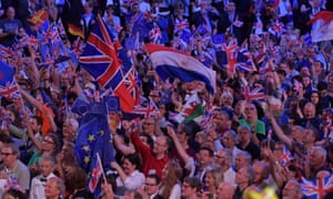 A range of flags being waved by members of the audience at the Last Night of the Proms.