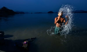 A man bathes in the Bratmaputra river in Guwahati, Assam. Many Indian states have been affected by drought and water scarcity this year.