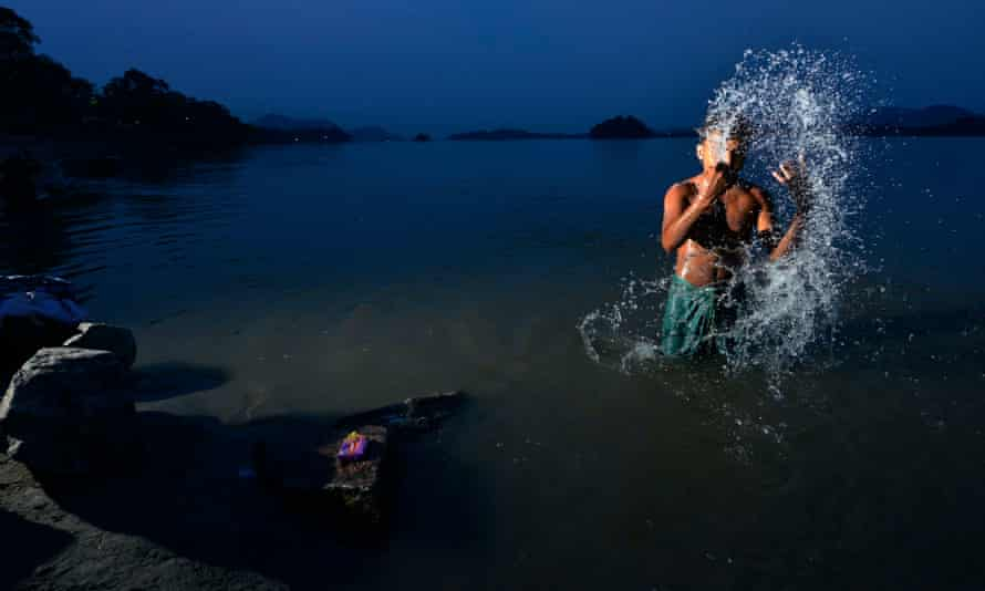 A man washes in the Brahmaputra river in Guwahati, Assam. India is embarking on a massive rivers diversion project to alleviate flooding and drought.
