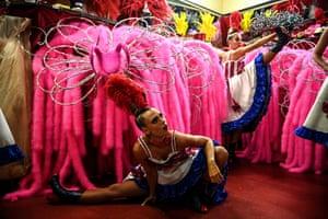 Dancers warm up offstage.