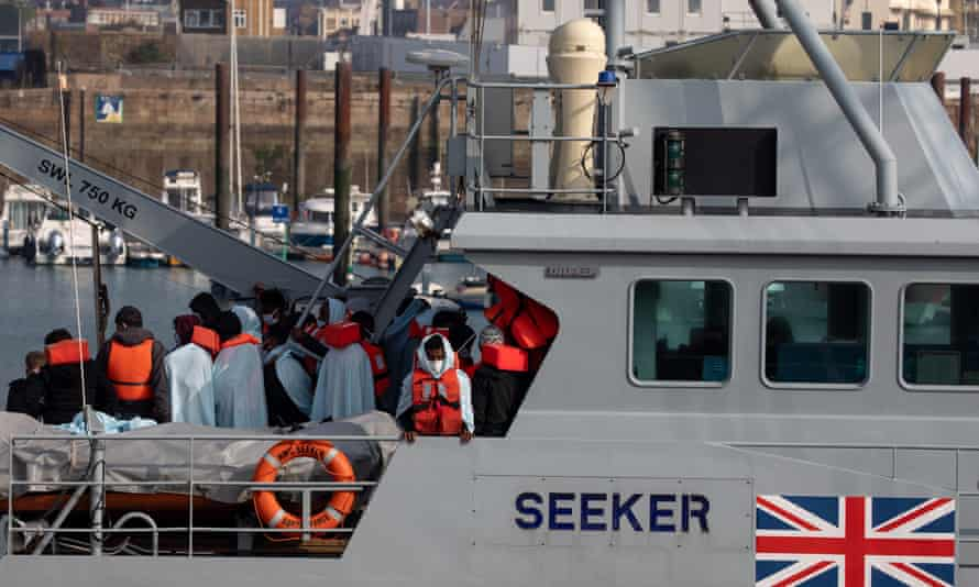 Migrants on board HMC Seeker after being intercepted in the English Channel by border force on September 22. Boris Johnson's spokesman said the UK was planning to reform the system to deter people 'from making life-threatening journeys'.