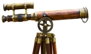 Antique brass telescope on white background