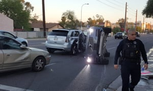 A self-driven Volvo SUV, owned and operated by Uber, lays on its side after a collision in Tempe, Arizona.
