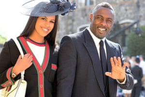 Idris Elba and Sabrina Dhowre arrive at St George's Chapel.