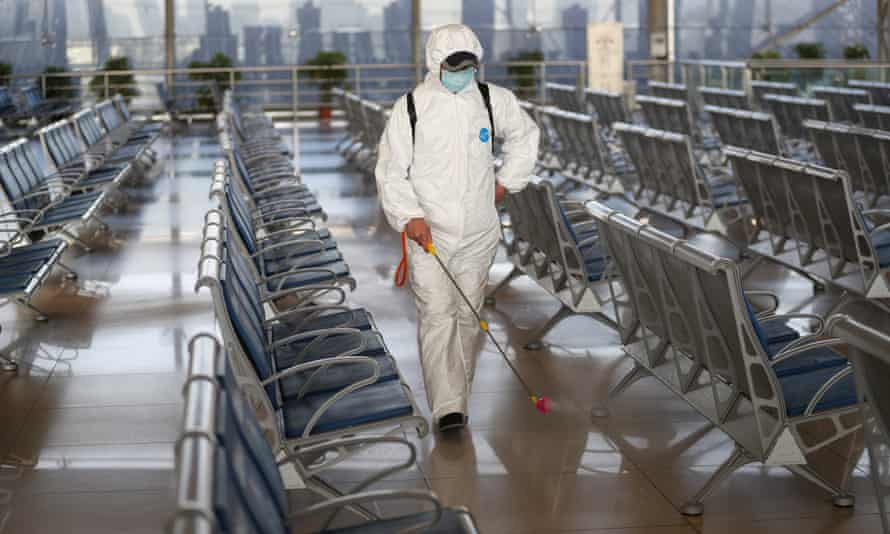 Nanjing Railway Station Takes Measures Against COVID-19 EpidemicNANJING, CHINA - JANUARY 14: Staff member in protective suit sprays disinfectant at the waiting hall of Nanjing Railway Station on January 14, 2021 in Nanjing, Jiangsu Province of China. Railway stations take prevention and control measures against the COVID-19 epidemic. (Photo by VCG/VCG via Getty Images)