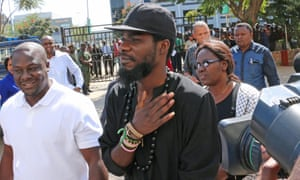 Chama Fumba arrives at Lusaka Central police station after police summoned him over his song.
