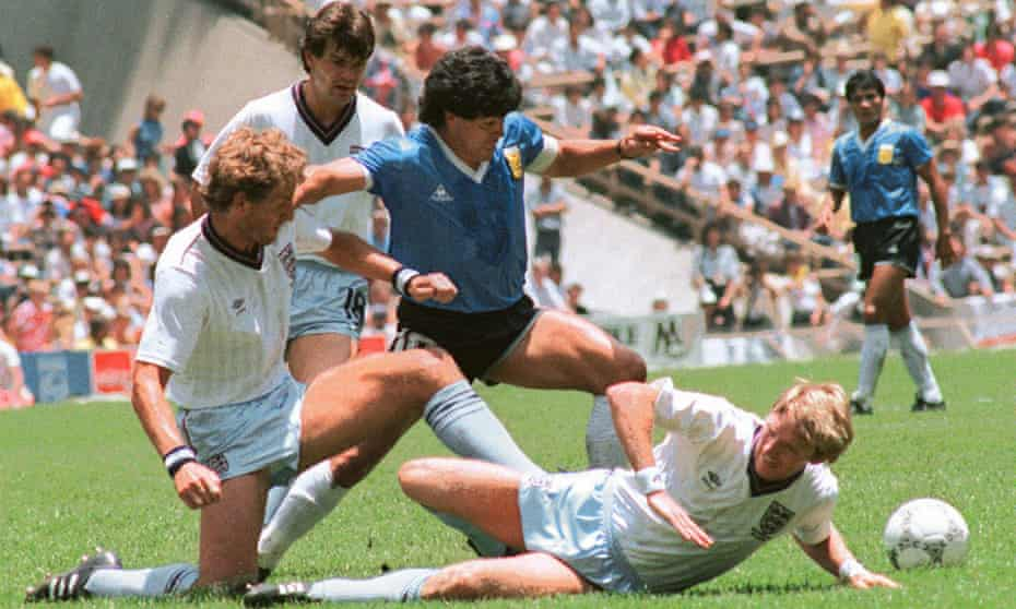 Diego Maradona takes on the England defence during Argentina's 2-1 win in the 1986 World Cup quarter-finals