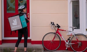 a deliveroo courier at a house door