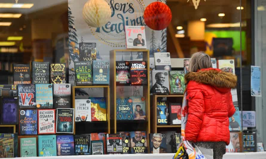 A woman looks through the shop window of Waterstones in Crewe during the November lockdown.