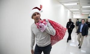 'Ho, ho, ho': Barack Obama delivers gifts.