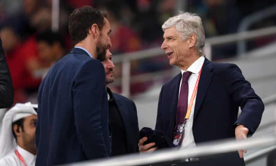 Gareth Southgate (left) talks to FIFA's global football development Arsène Wenger (right) at a Club World Match match in Qatar.
