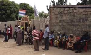 Supporters gather outside the home of the Gambia's president-elect, Adama Barrow, in Banjul.