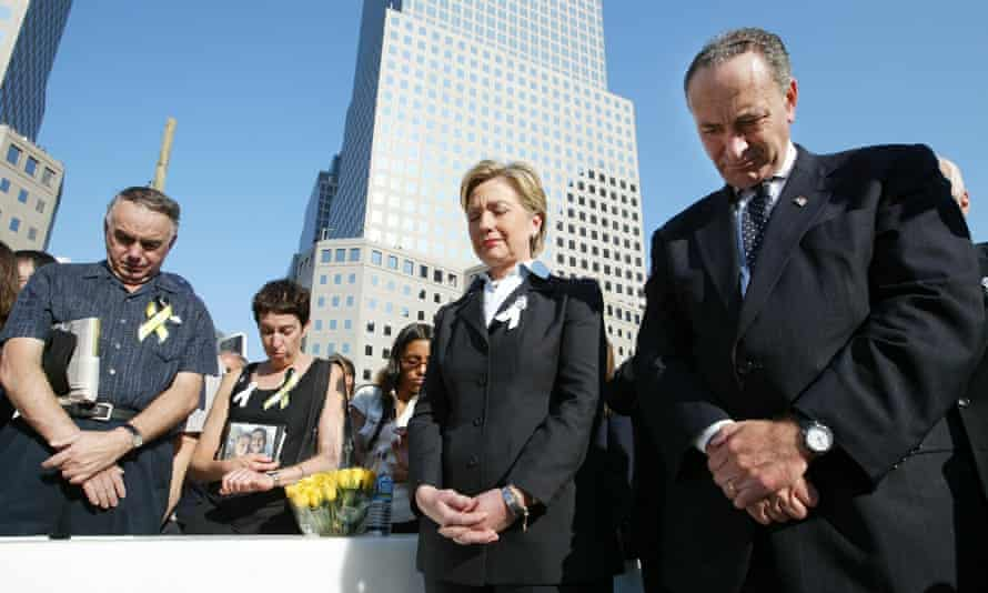 Hillary Clinton and Charles Schumer bow their heads during a moment of silence at Ground Zero.