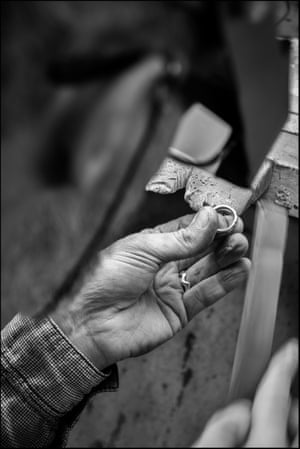 Dibben puts the finishing touches to a gold ring before displaying it in his shop
