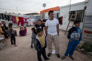 Syrian refugee Younis Haraki, 19, in camp Za'Atari with family members.