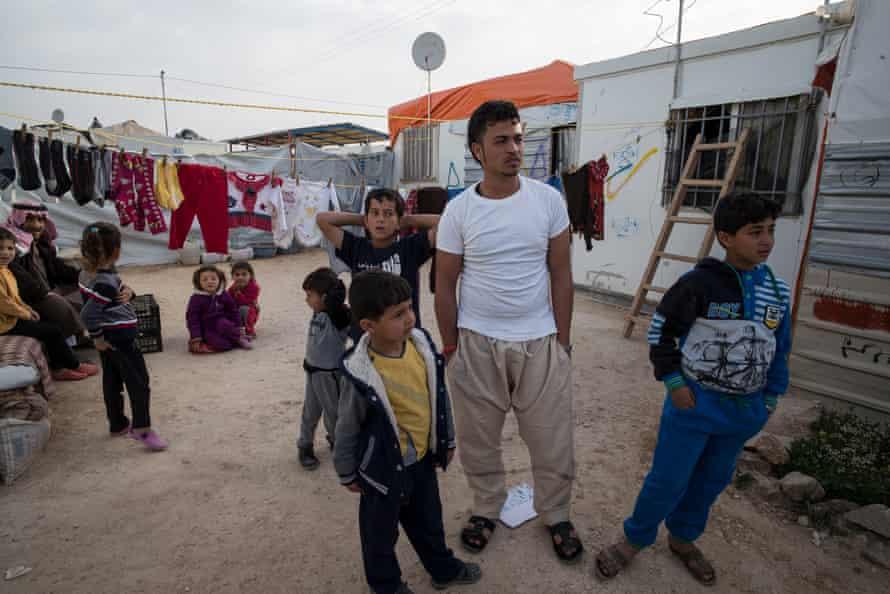 Syrian refugee Younis Haraki, 19, in camp Za'Atari with family members.