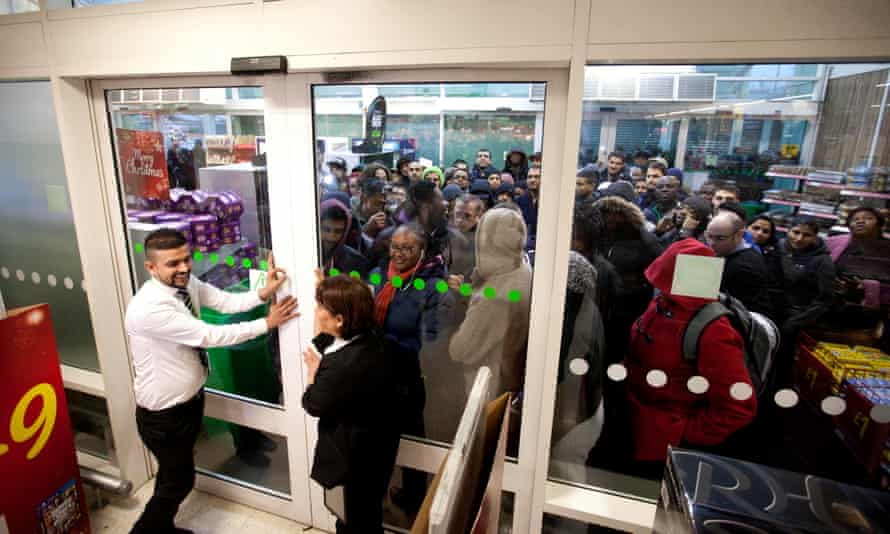 Shoppers at the Asda store in Wembley, north-west London, queue for Black Friday offers in 2014.