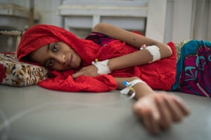 A 13-year-old girl is treated for cholera at the al-Sadaqa hospital in Aden