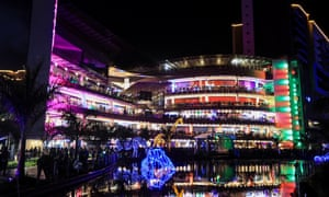 Hundreds of Kenyans gather on balconies as they watch a fireworks display during New Year's Eve celebrations at the Two Rivers Mall in Nairobi, Kenya.